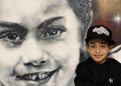 050-Arat-Hosseini-future-football-star-with-wall-mural-portrait