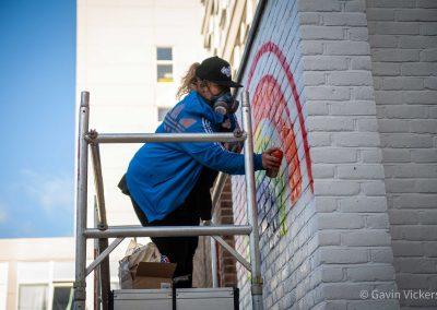graffiti-artist-paints-wall-for-NHS